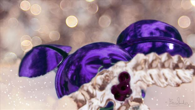 Dark Purple Christmas Balls in the snow with bokeh background