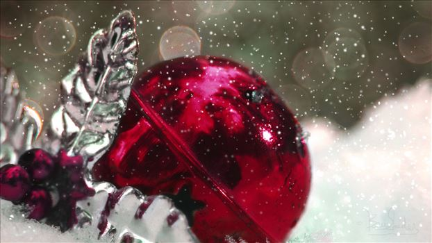 Fuschia Christmas Ball in the snow with bokeh background